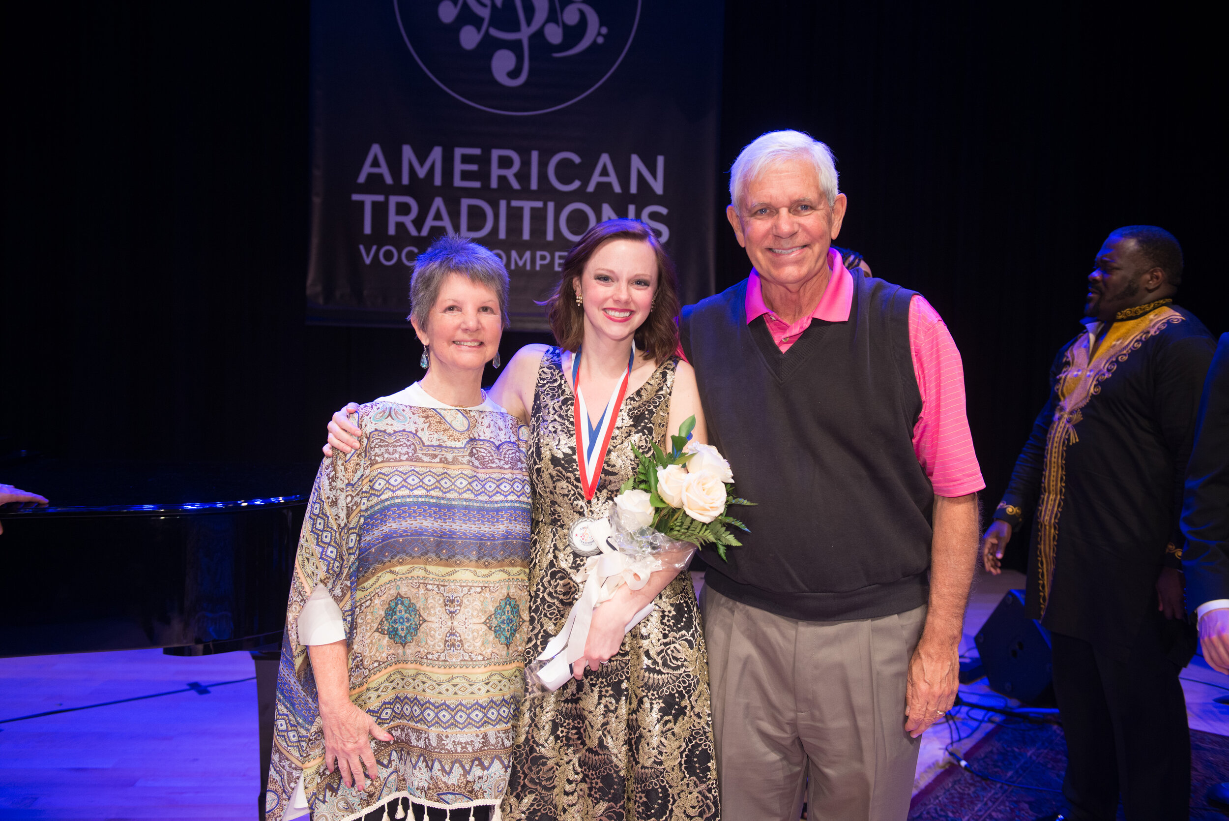 2019 Silver Medalist Emily Yocum Black and her sponsors, Melissa and Jim Emery.
