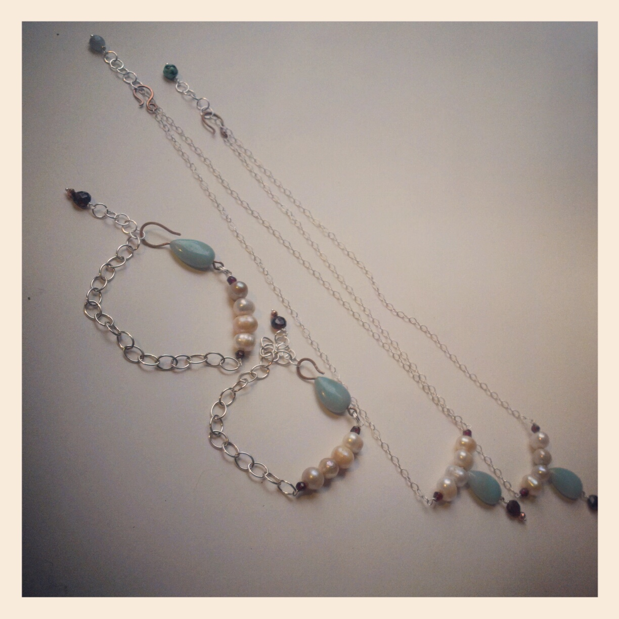 A commissioned series completed in 2012 featuring amazonite, freshwater pearls, pyrite, sterling silver, and copper.