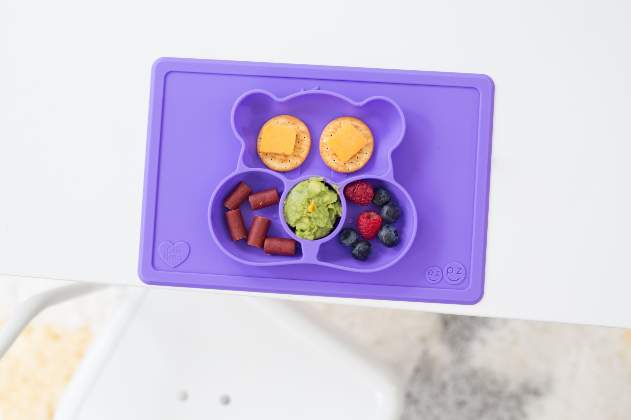 EZPZ -  EZPZ was created to help make meal time fun and enjoyable for you and your minis!  They offer mats, bowls, and even activity mats.  All are made from food grade silicone, so no threat of plastics contamination!