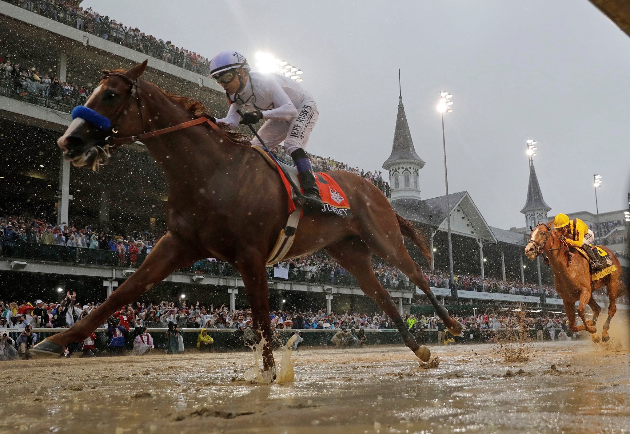 Justify winning the Kentucky Derby 2018 in the slop, before going on to win all three races in the American Triple Crown