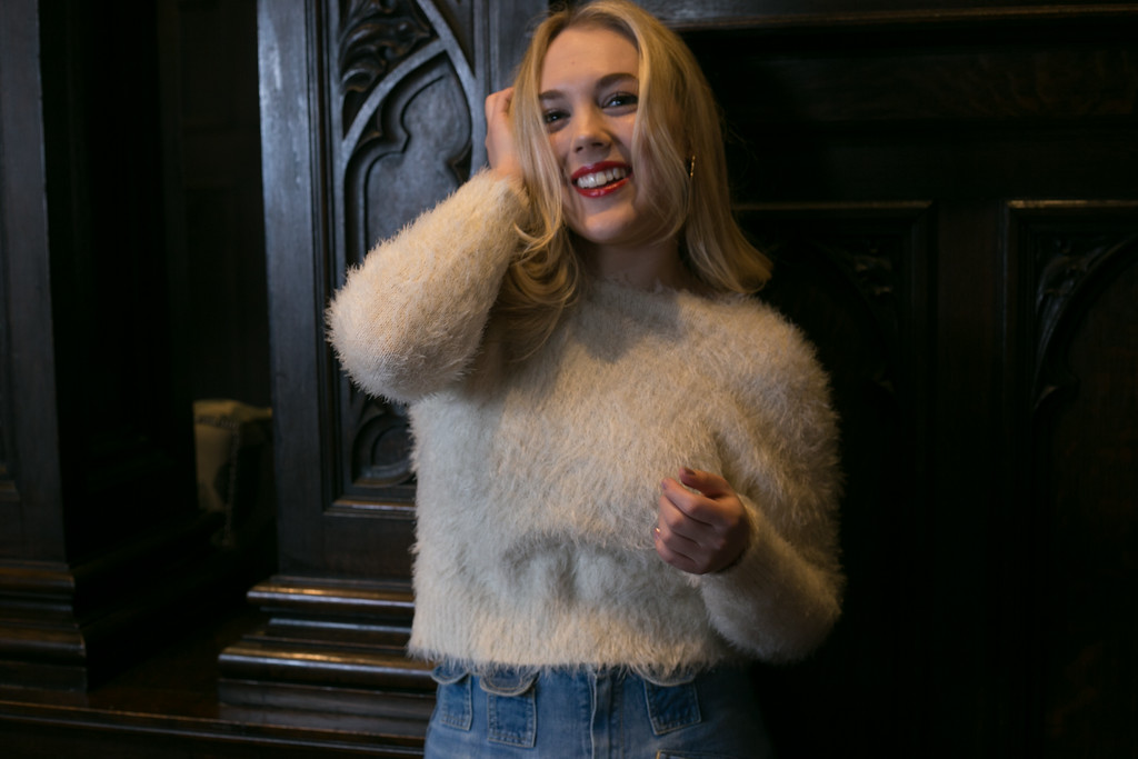 bell bottoms white sweater candid one arm up.jpg