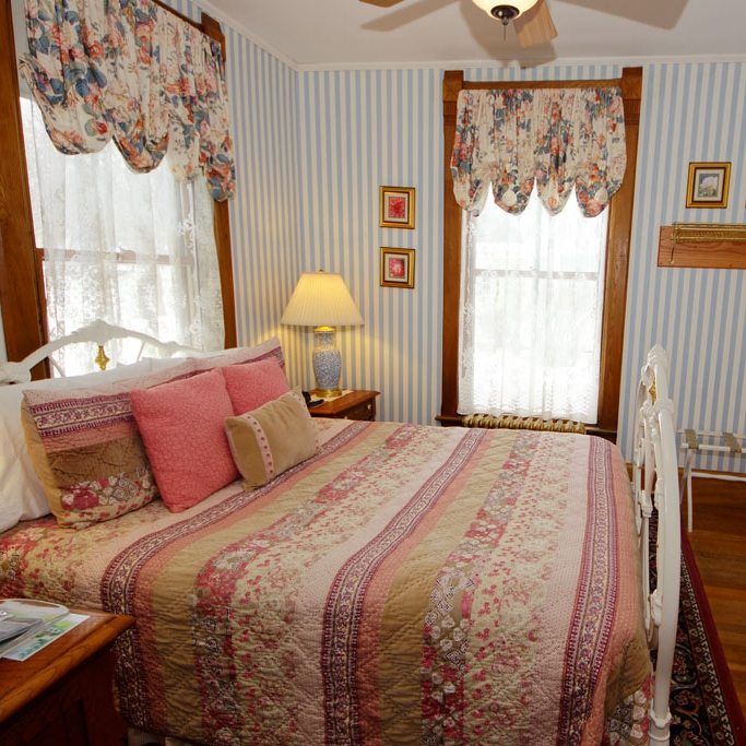 Petit Manan - This intimate room harmonizes the warmth and character of turn-of-the-century style. Located on the first floor.Room Features: Value queen bedded room, en-suite bathroom and separate en-suite tub/shower.