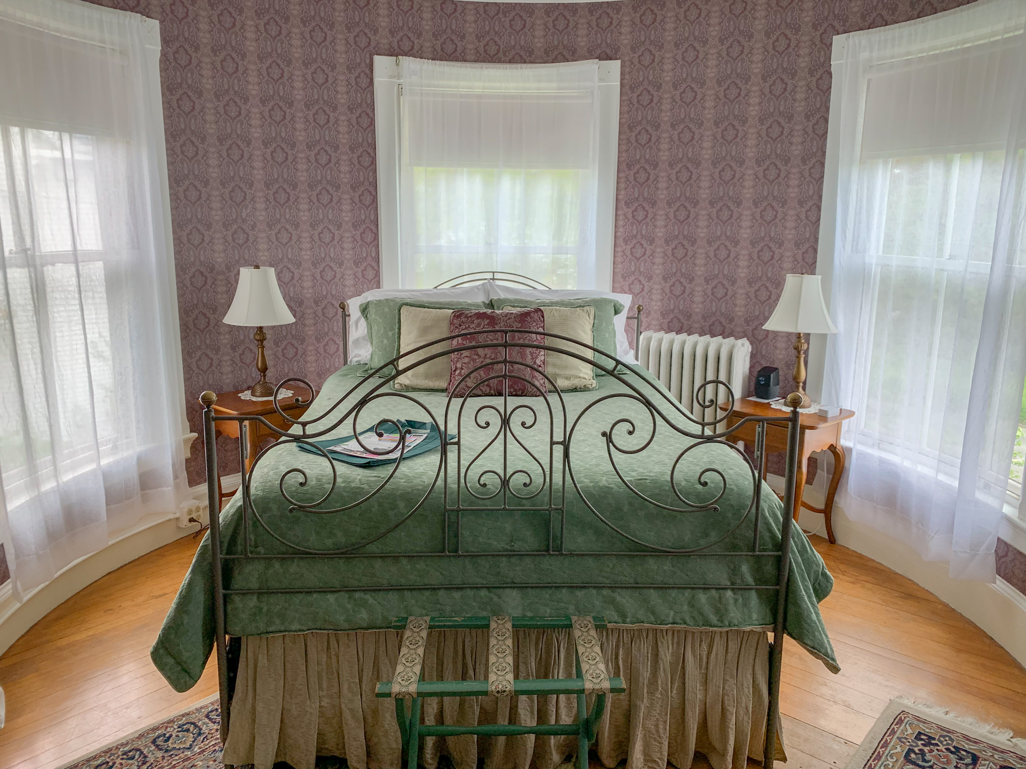 Turret - Romance abounds in our largest guest room featuring luxury appointments and classic Victorian style. Located on the second floor.Room Features: Luxury queen bedded room, sitting area, full large en-suite bathroom with clawfoot tub and separate shower.