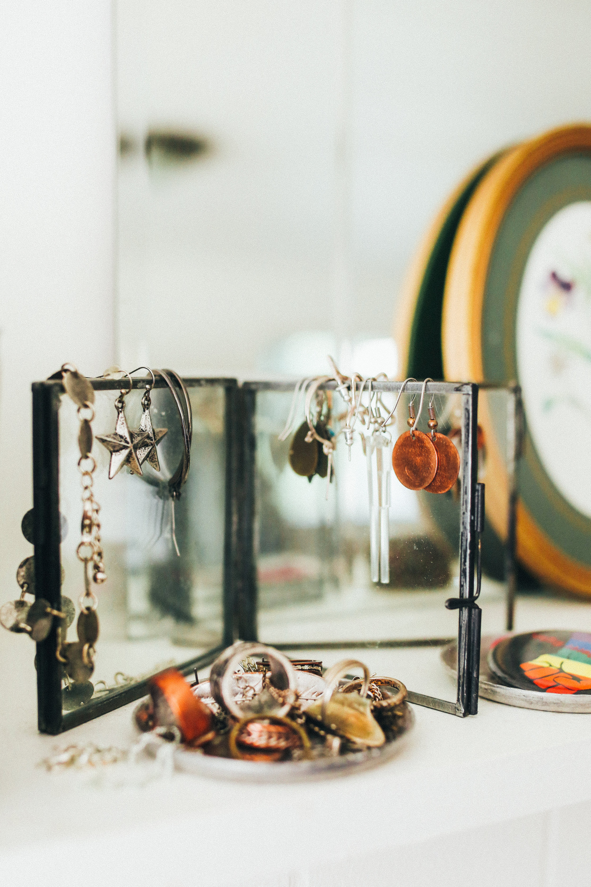 This was a glass photo frame from World Market, but I've been using it to display all of my earrings, (most of which are thrifted, big surprise)