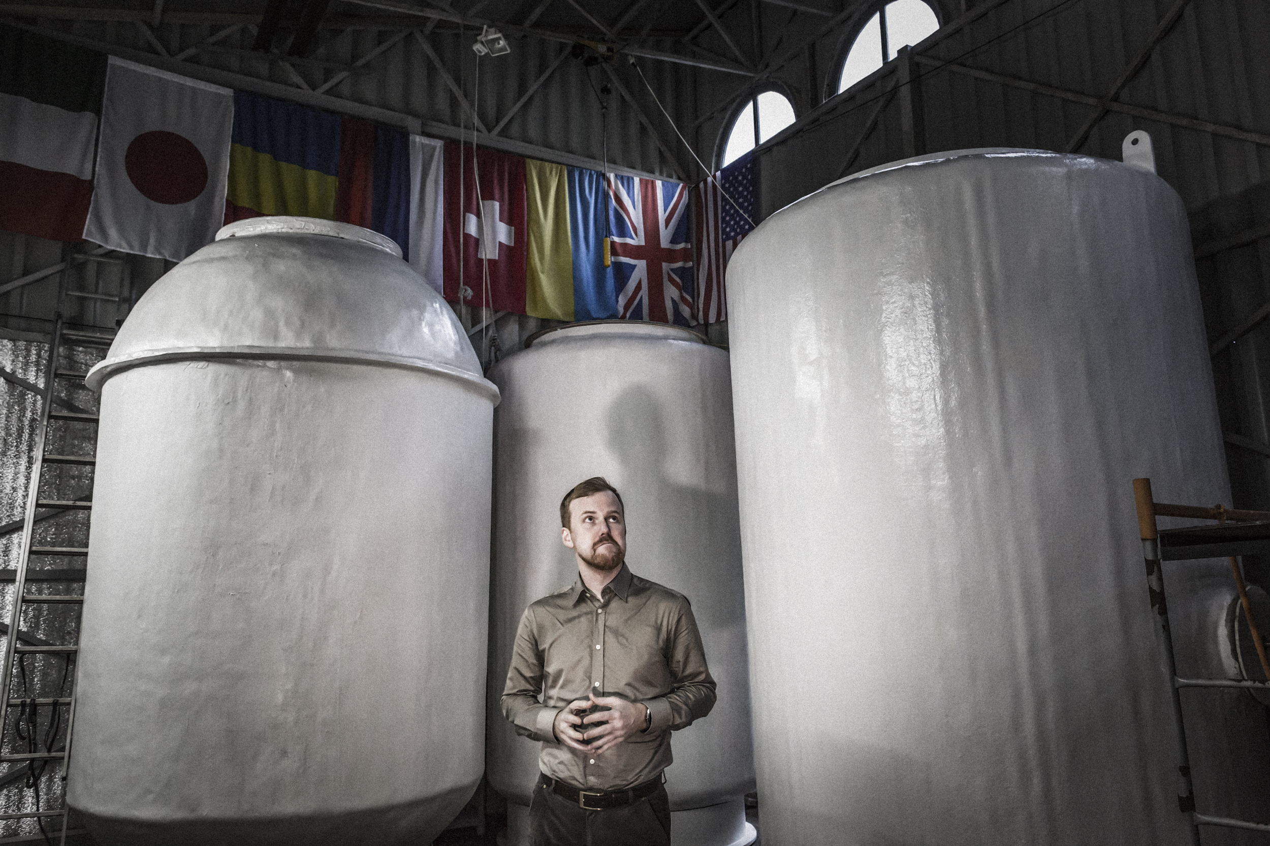 "ergiev Posad, Moscow region, Russian federation, June 2017. Danila Medvedev, member of the Governing Council of the Russian Transhumanism Movement and Kriorus founder in May 2005. In the background the three dewars in which the patients' bodies are cryopreserved. The three ""Pots"" are classified as Anabiosis 1, 2 and 3, and each of them can contain up to 8 bodies."