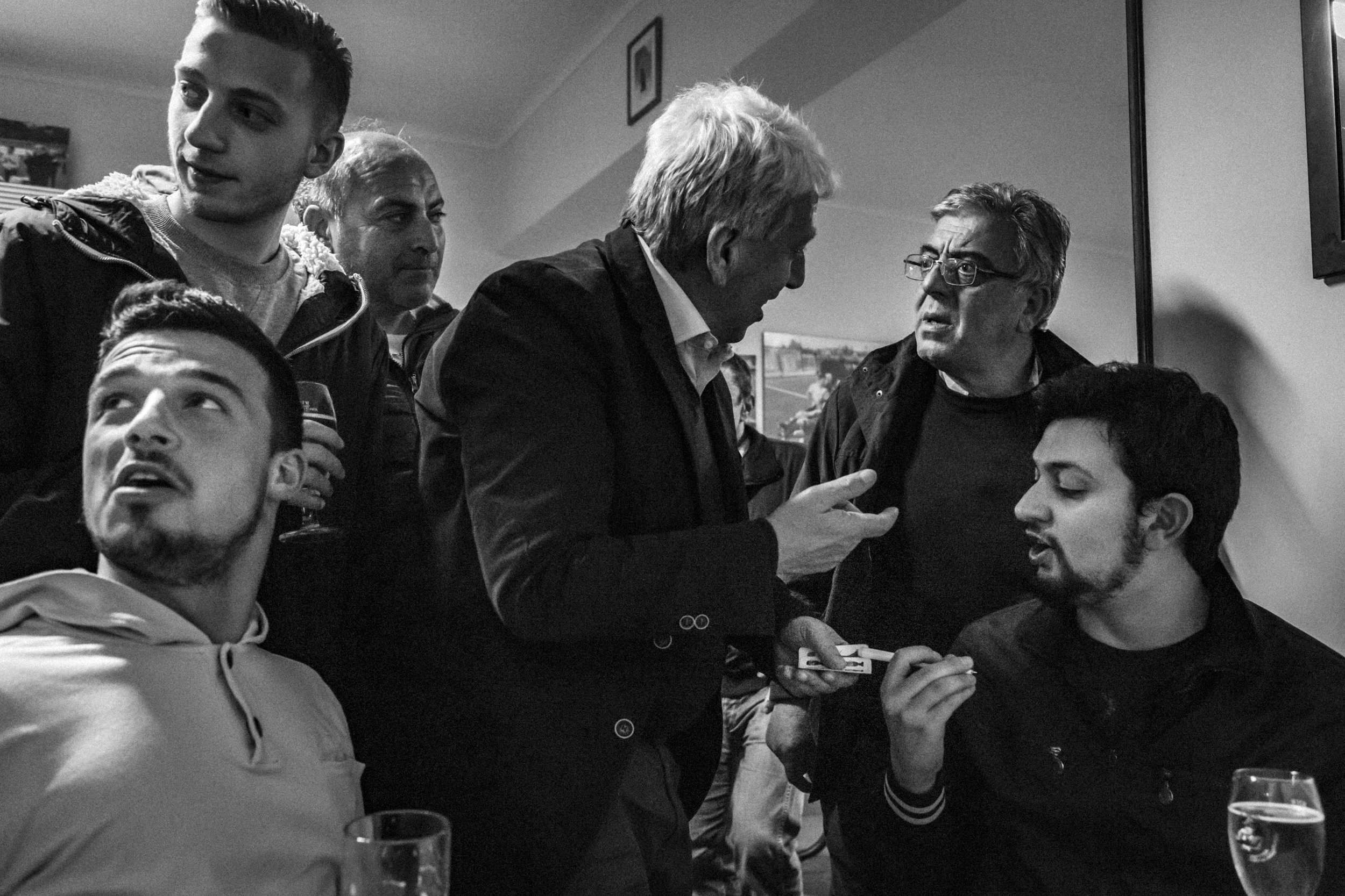 "Vastogirardi (IS), Italy - May 2016. At the historical bar in the central square, a group of friends plays ""passettella"" before going home for dinner."