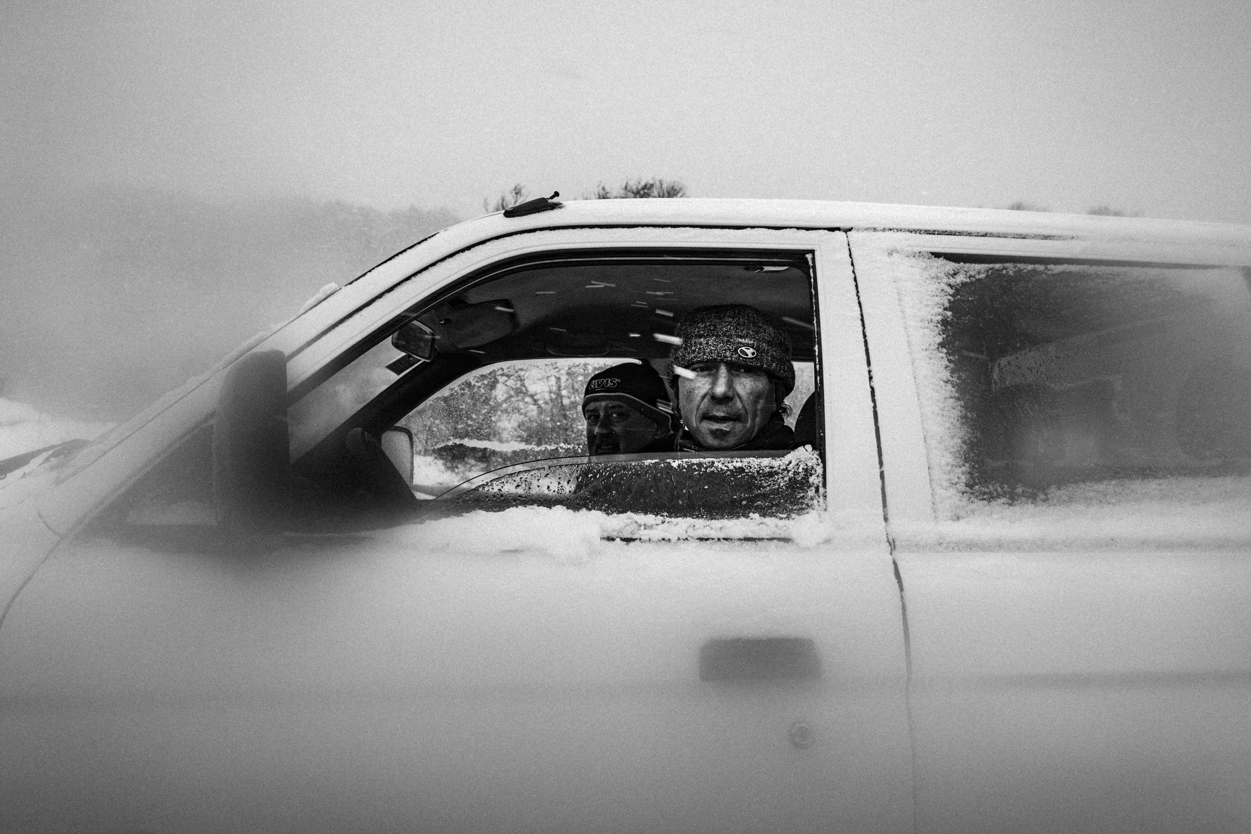 Capracotta (IS), Italy - January 2016. Venditti Giacomo and a friend in the middle of a storm, while returning to the village at the end of their daily activities related to livestock farming.