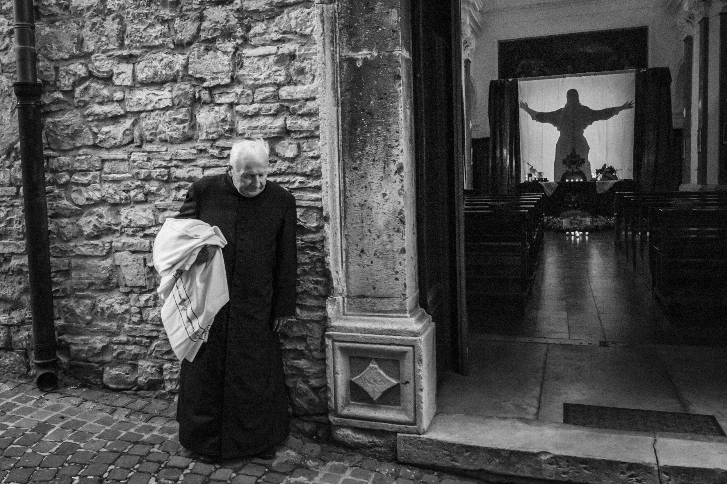 Agnone (IS), Italy - April 2017. Father Don Alessandro Di Sabato at the exit of the Santa Croce Church after the opening of the Sepulchre, typical of Holy Thursday.