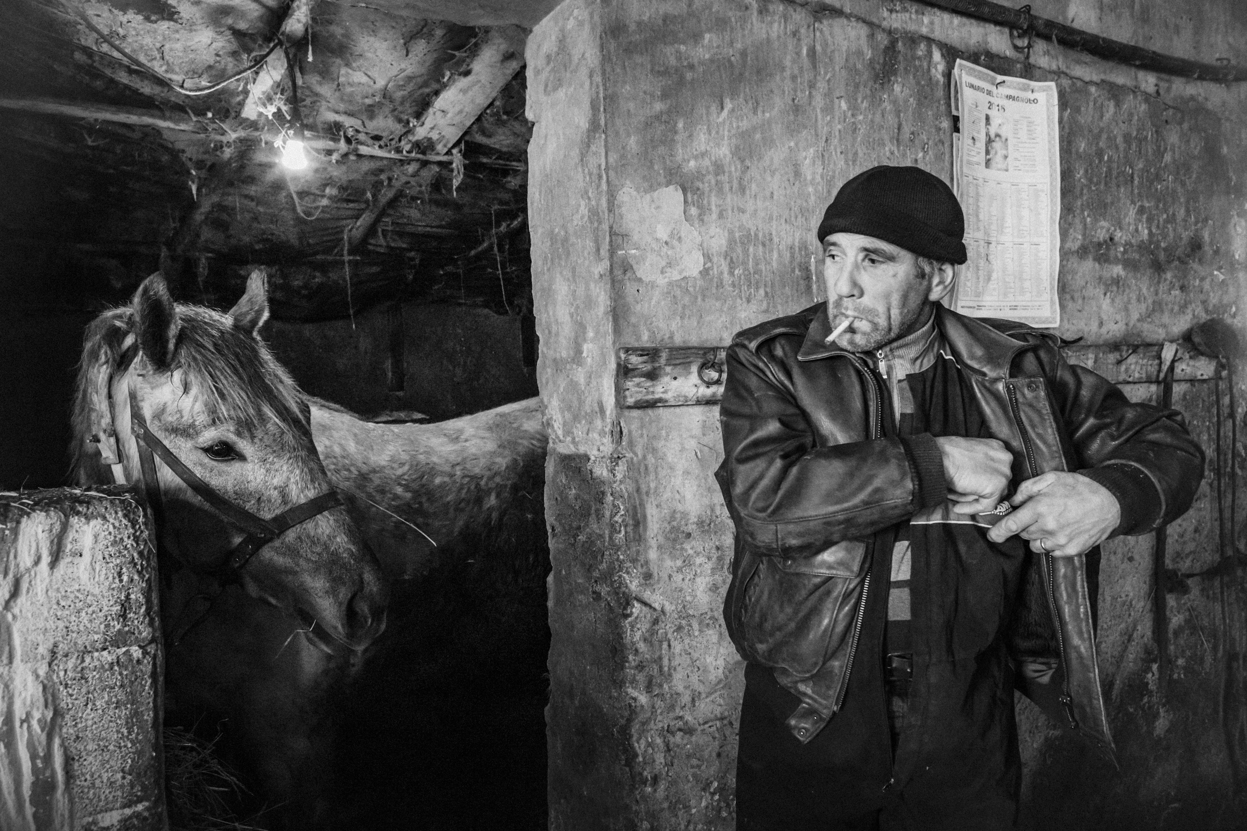 Capracotta (IS), Italy - February 2016. Giovanni Di Pietro, working as a street cleaner for the municipality of Agnone, in the family stable with his horse.