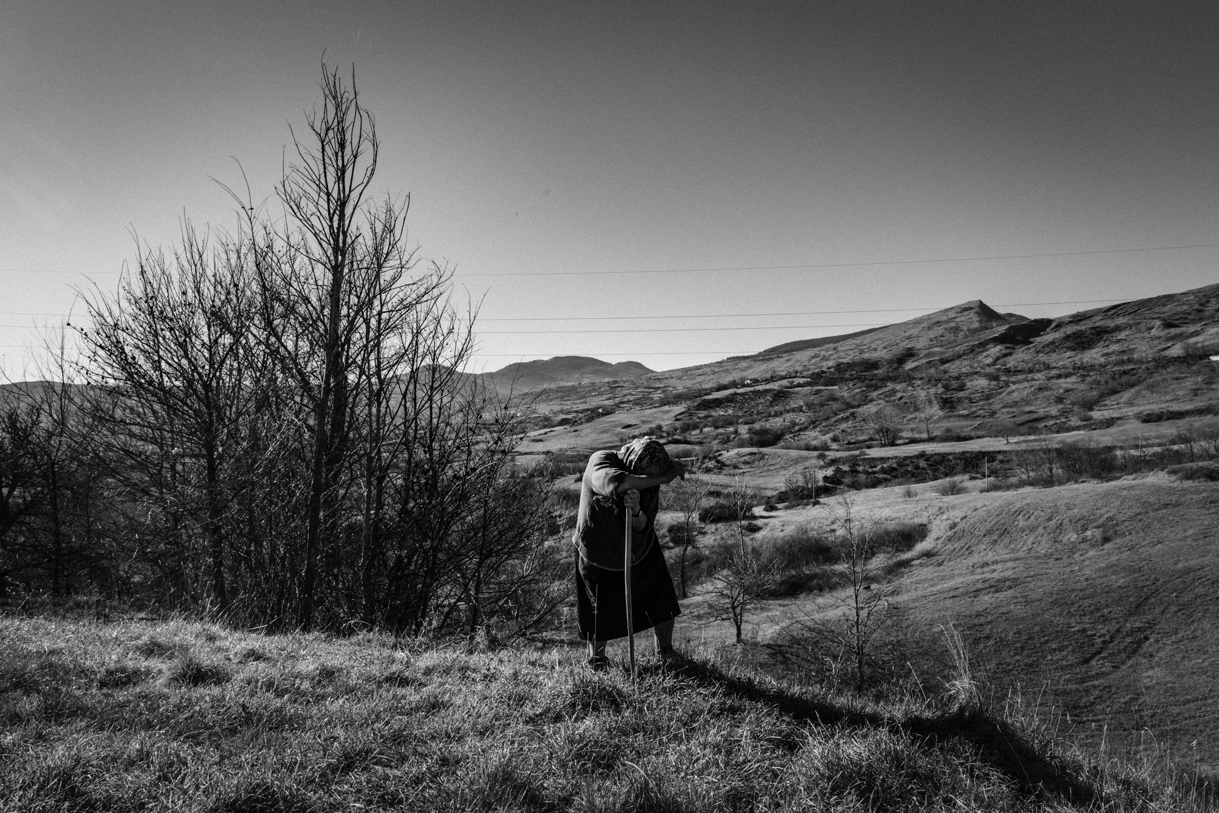 "Agnone (IS), Italy - December 2016. Nearby the locality of ""Guado Liscia"", the she-shepherd Teresa Masciotra, born 1949, observing her flock, which she is pasturing together with her brother, since she was a child. She spent all her life living in a masseria, few hundred meters from where she is now."