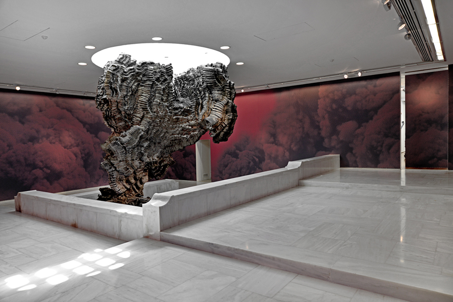 Mise-en-Scène_Red Smoke 2015  Digital print on vinyl Sculpture by Roberto Cuoghi, Belinda, 2013 Photo: Fanis Vlastaras & Rebecca Constantopoulo