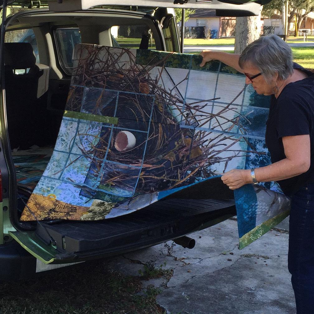 bobbibaughstudio-art-quilt-loading-into-car.jpg