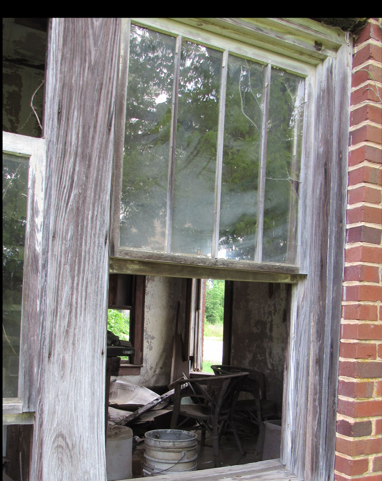 I was intrigued with this view – looking through the window, into the abandoned interior, and through the door and window on the other side