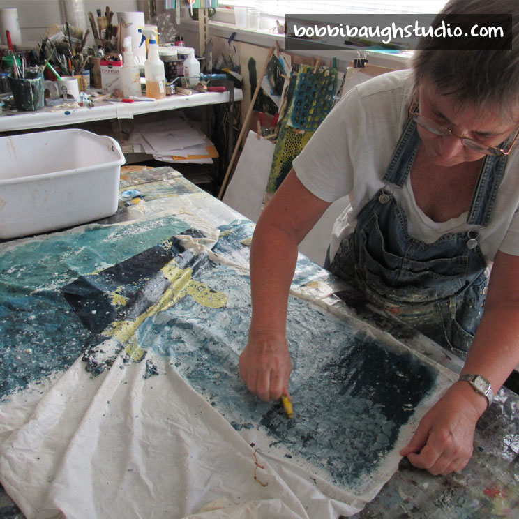 5-bobbibaughstudio-scraping-wheat-paste.jpg