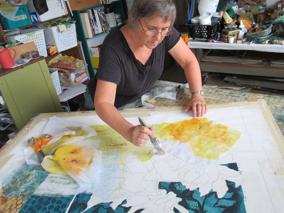I created pieces of transparent fabric in vibrant yellows and oranges to collage into the flowers. Printed loosely, wet-into-wet. I did not cut the fabrics to fit my sketch tightly. I wanted a freer construction for this work.