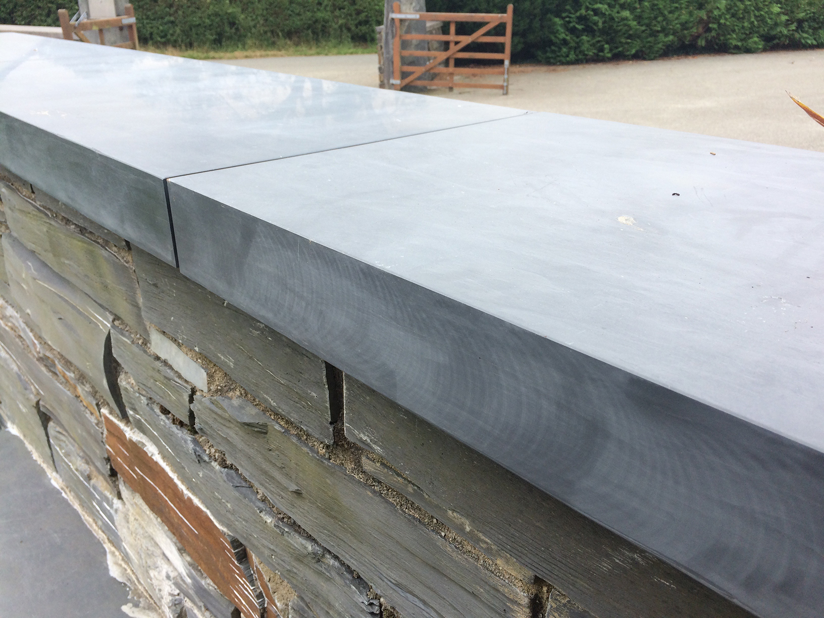 Polished Welsh slate copings