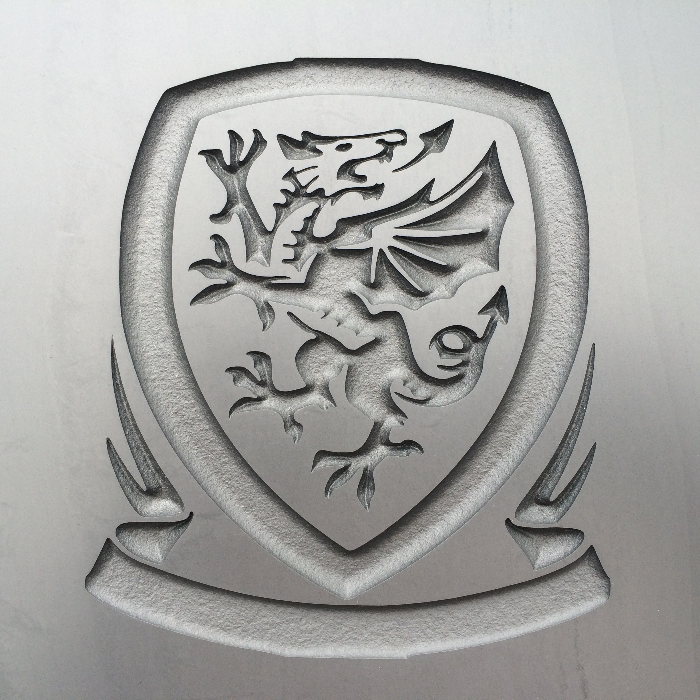 Engraved logo of the Welsh football team