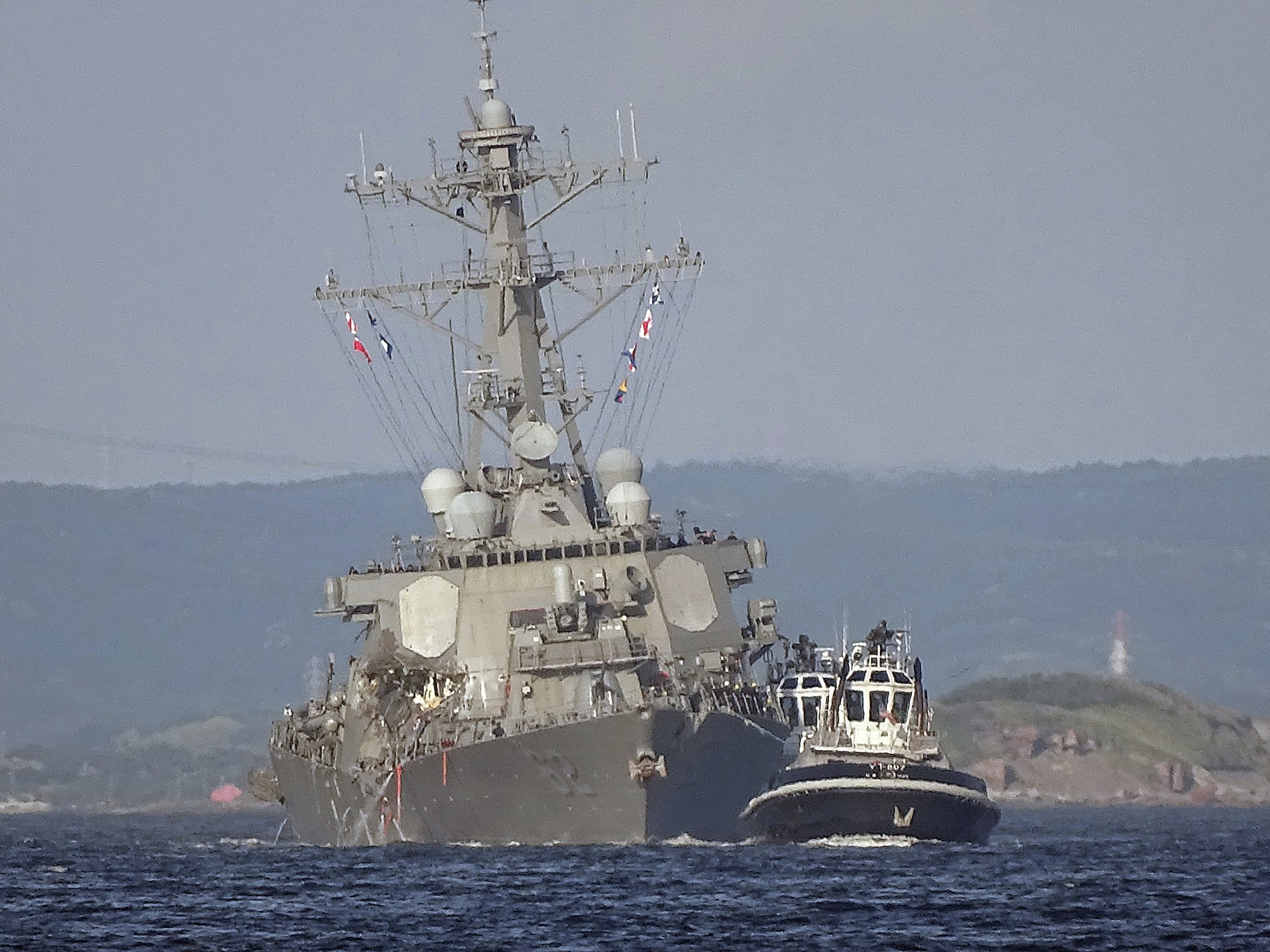 The USS Fitzgerald in tow after the collision