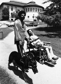 The Rolling Quads -- Ed Roberts with one of the revolutionary brothers, Berkeley, California, late 1960s