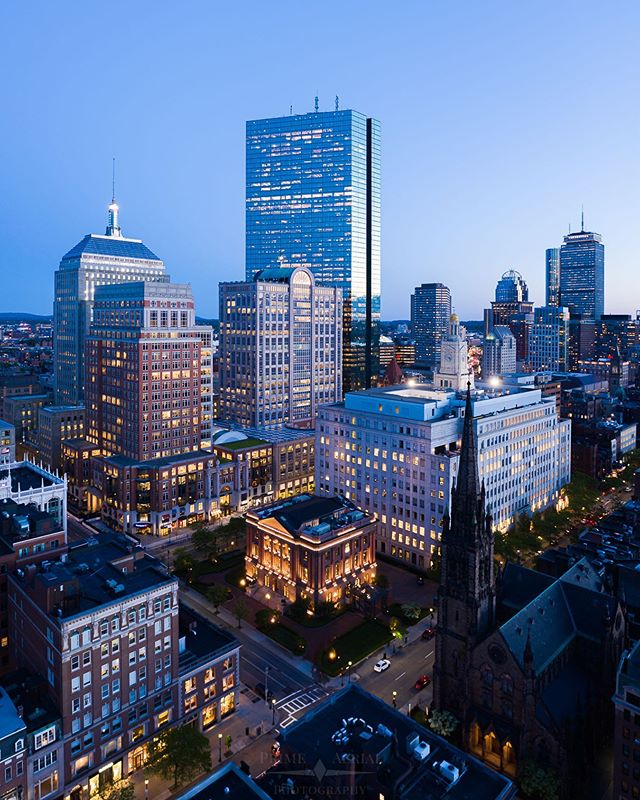 Blue Hour in Back Bay. Taken the same night as my Prudential shot I posted earlier this week, it was amazing to watch the skyscrapers light up as the sunset faded from orange to blue 👌💙 • This shot was taken under special authorization for increased altitude in Class B Airspace
