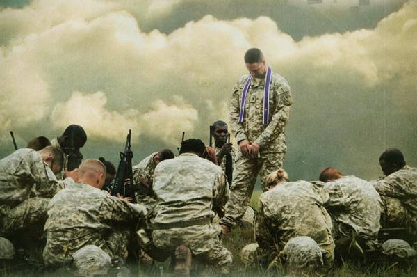 Chaplain-praying-in-the-field.jpg