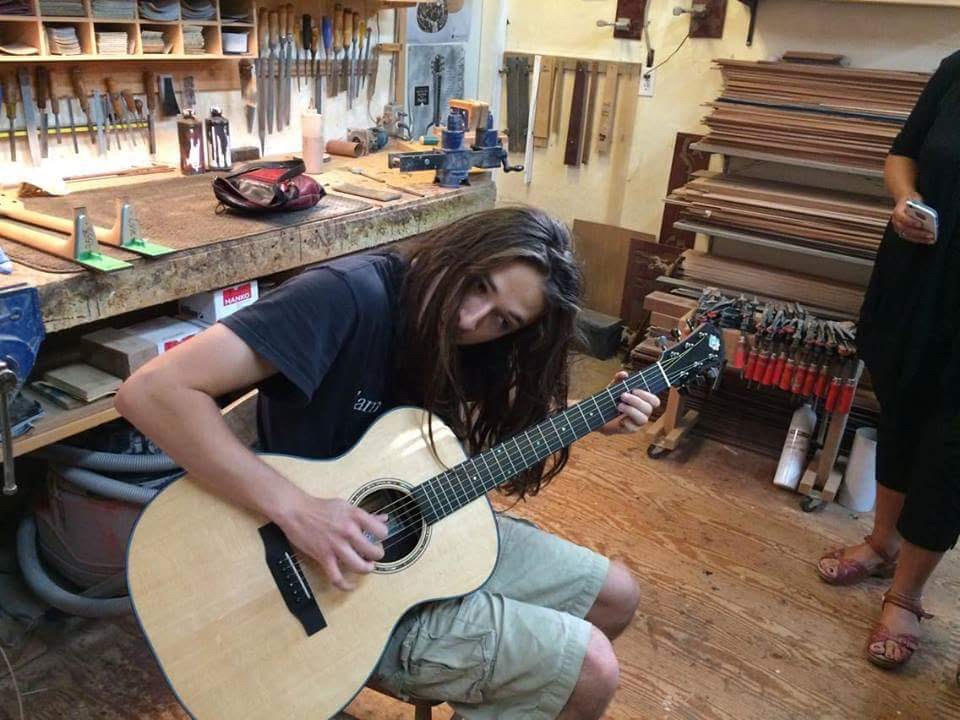 Farley trying out his new guitar in David's workshop.