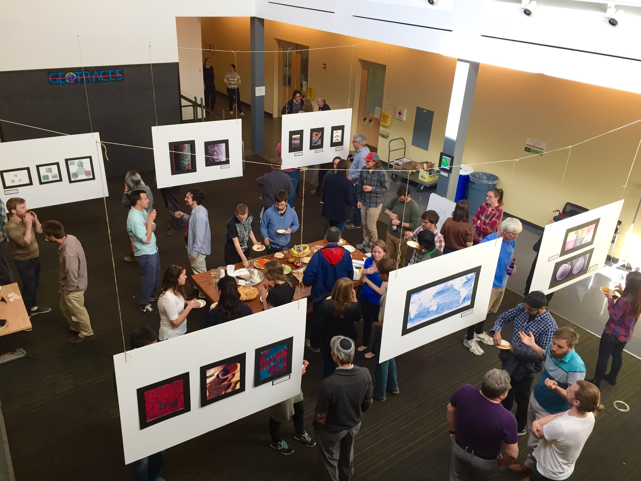 Attendees enjoying the images submitted to the 4th annual LDEO Research as Art exhibition (2017) from above.