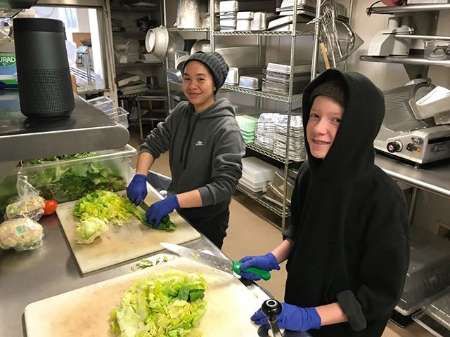 Students from the @seattleacademy helping prep salad at the Ozanam Housing for adults.