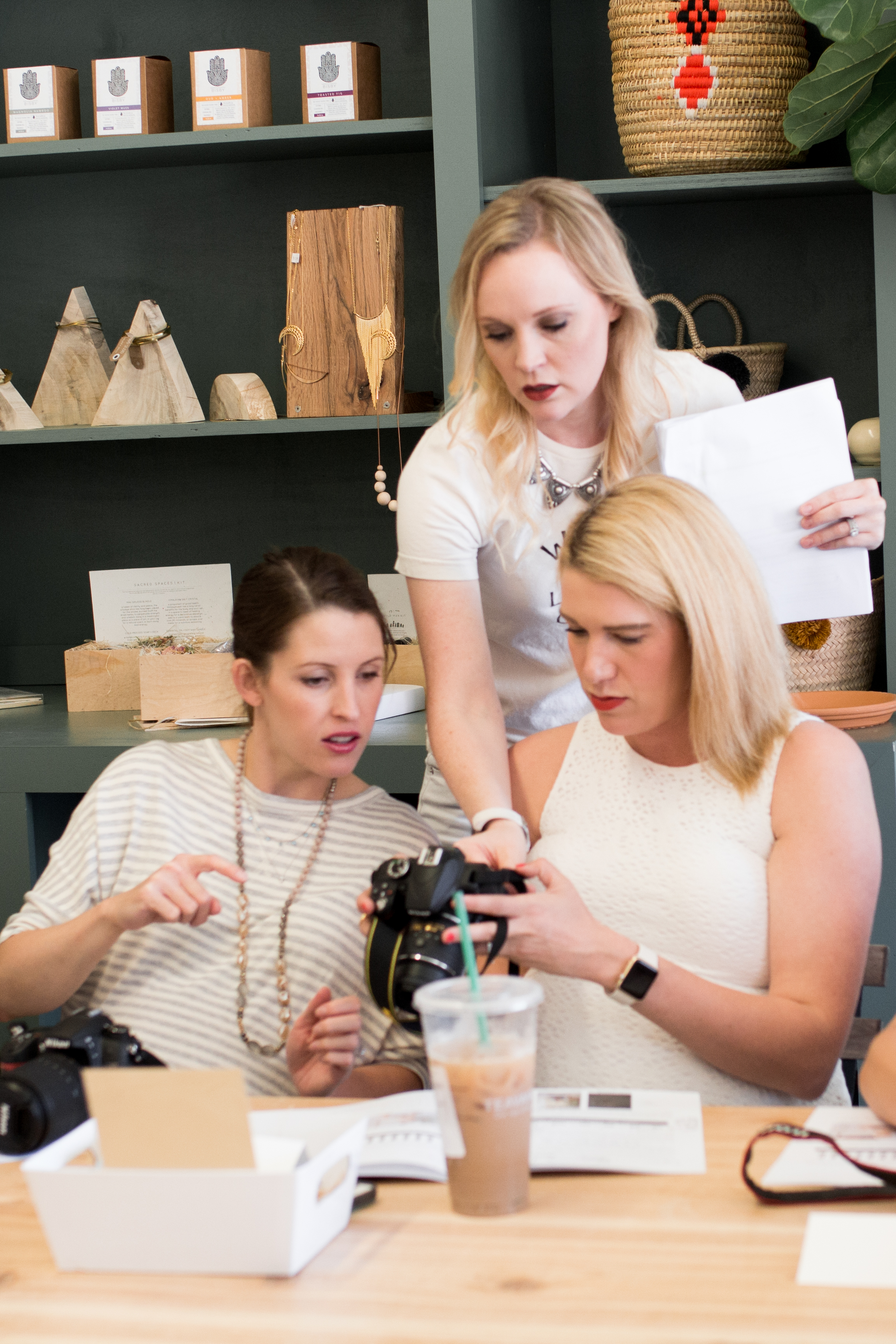 Angela helping moms with their DSLR cameras at  Kindred  Tulsa,Image by  Tina Lynn Photography