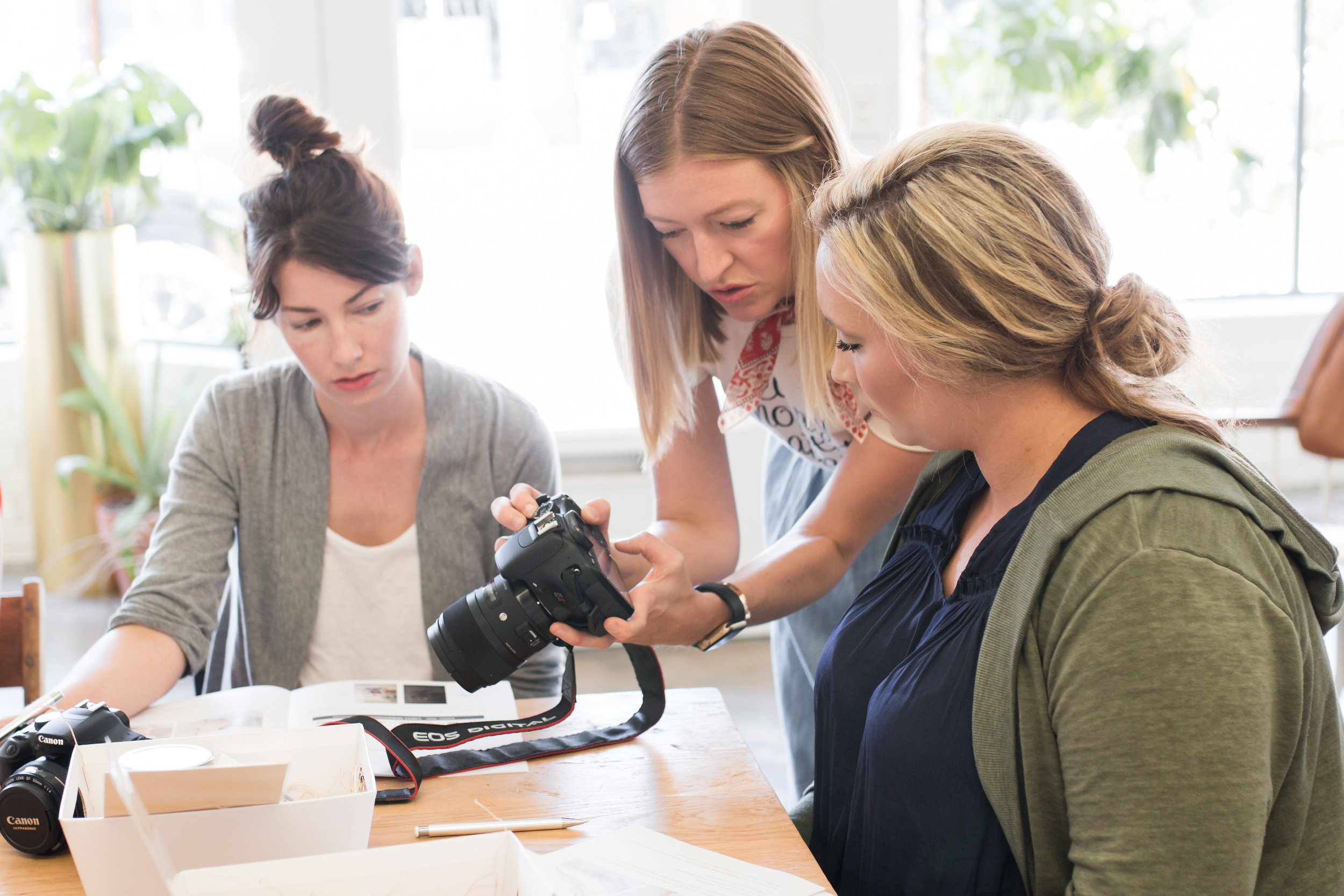 Kacey helping attendees find shutter speed function at  Kindred Photography Workshop  Tulsa, Image by  Tina Lynn Photography