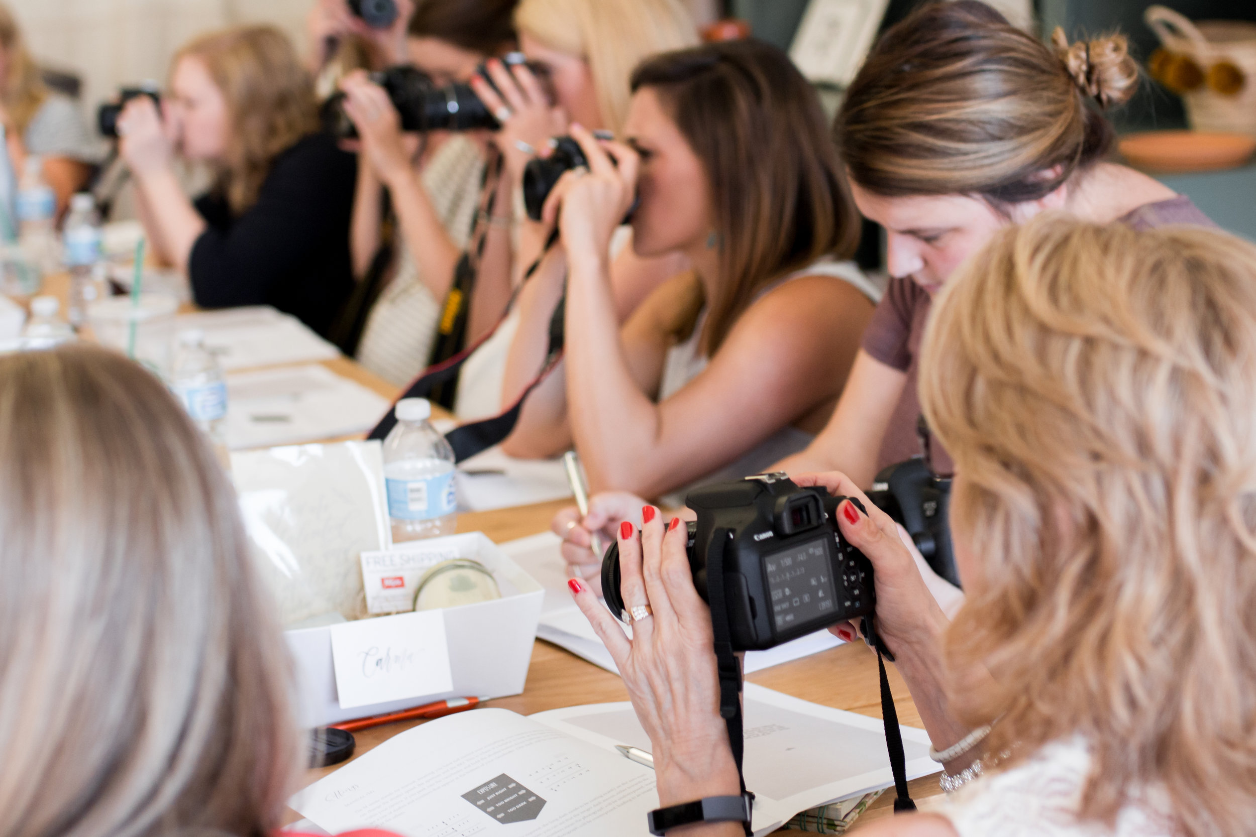 Workshop attendees practicing with DSLR camera at  Kindred Photography Workshop , Image by  Tina Lynn Photography