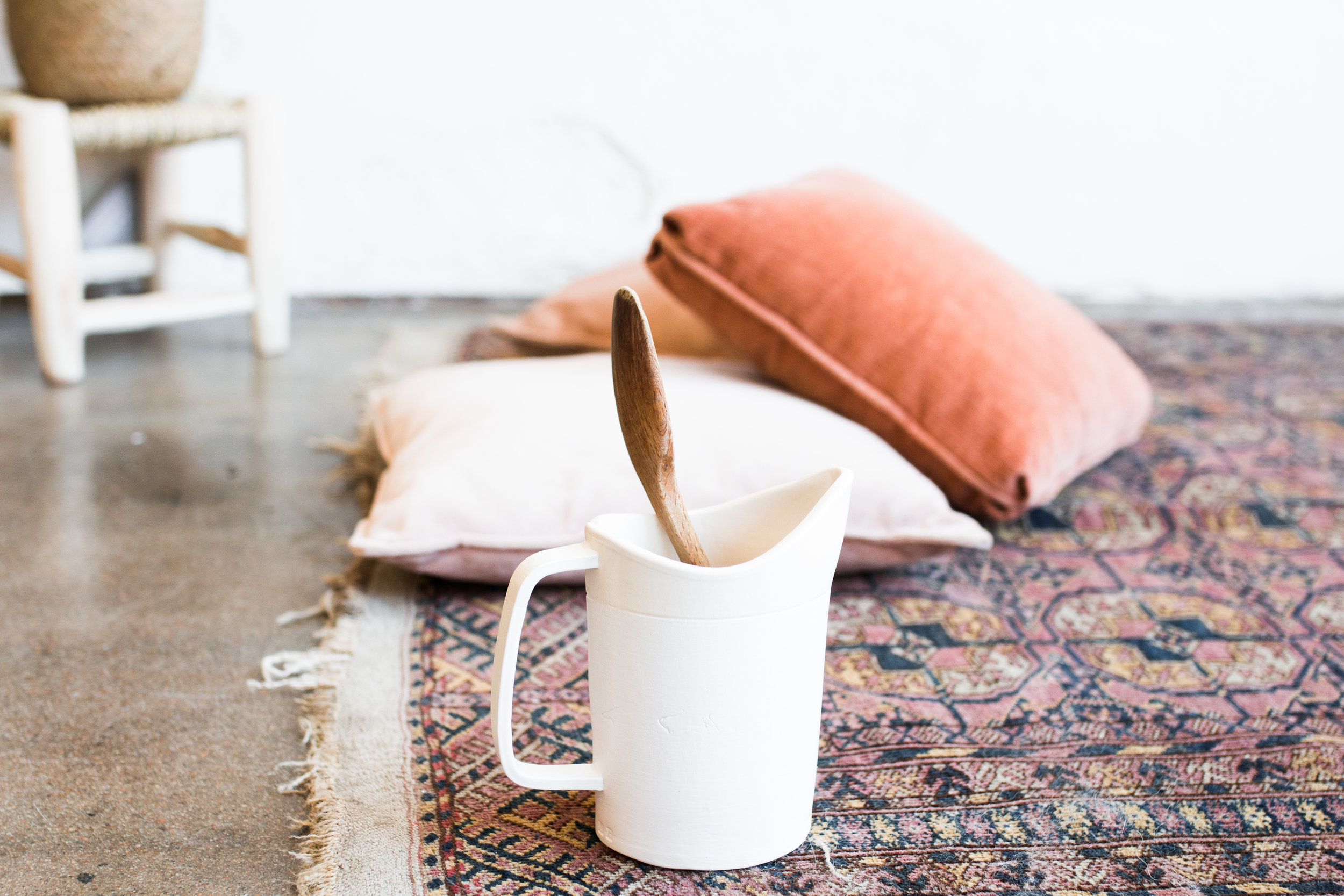 Here is a simple example. This image has a SHALLOW depth of field and a WIDE aperture. The pitcher and spoon are in focus, the surrounding elements are out of focus. This image was shot at f/2.8. (Image taken by  Tina Lynn Photography  from Kindred Photography Workshop - Tulsa)