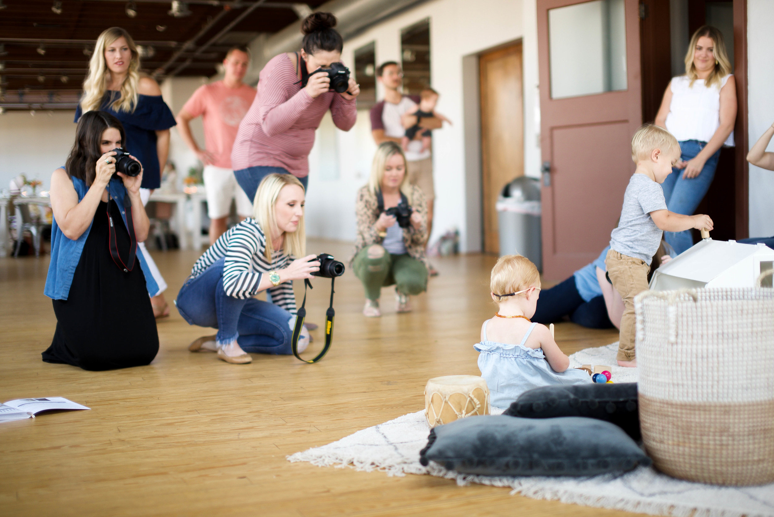 Mamas practicing manual mode at  Kindred Photography Workshop , Photo by  Kacey Gilpin
