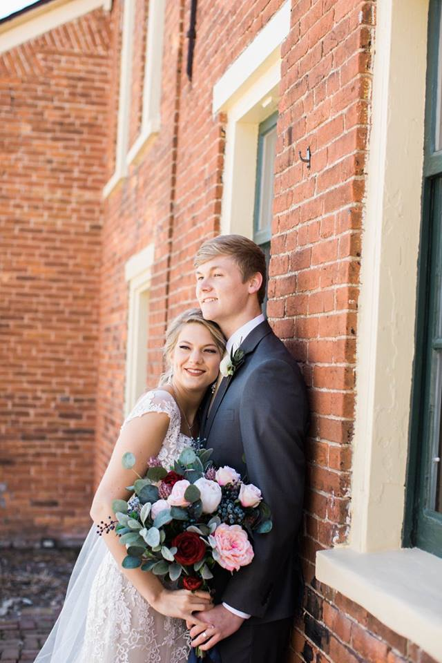 """Jenna + Brandon - """"Maggie did such an awesome job with our arrangements on our wedding day! She helped us stick to our budget and rented out a few pieces to us to make our floral looks complete. We loved working with Maggie. She's so easy to work with and always has a smile on her face! """" - Jenna H.[Lauren McDonald Photography - 2017]"""