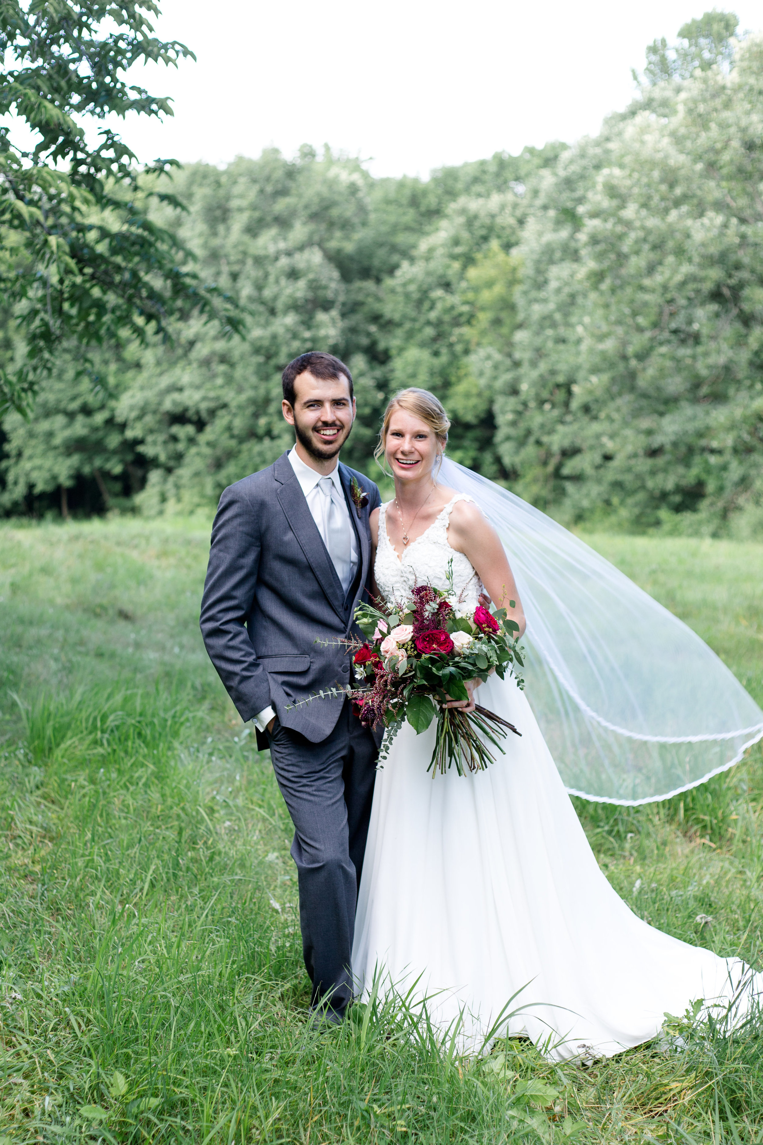 """krista + elijah - """"Thank you, Maggie, for all you did to make my wedding GORGEOUS! The flowers you designed and provided were far better than I could have ever imagined. We received so many compliments about them on our wedding day. I loved looking down at my beautiful bouquet throughout the day. WOW.Thank you for thinking through every detail with us and getting each piece labeled, where it needed to go, and communicating with us well. You helped make our wedding day go so smoothly and added the color, florals, and decor it needed to make it extra special.Each time my mom and I met with you at the store I knew we were in good hands. Thank you for being patient with us and taking on our vision and making our flowers unique. You are so talented and kind. I will 100% recommend Thistles to others in the future!"""" - Krista S.[Lindsey Klyn Photogrpahy & Design - 2018]"""