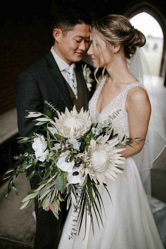 """Jo + Nathan - """"Maggie and the ladies at Thistles are the best in the business. Maggie was patient, encouraging, organized, willing to work with any budget, and always willing to answer any questions! Maggie took what was in my head and then made that dream even more beautiful than I could have imagined. I get so many compliments on how beautiful the flowers were! Best decision you will ever make!"""" - Johanna S.[Kiley Vander Maten Photography - 2019]"""