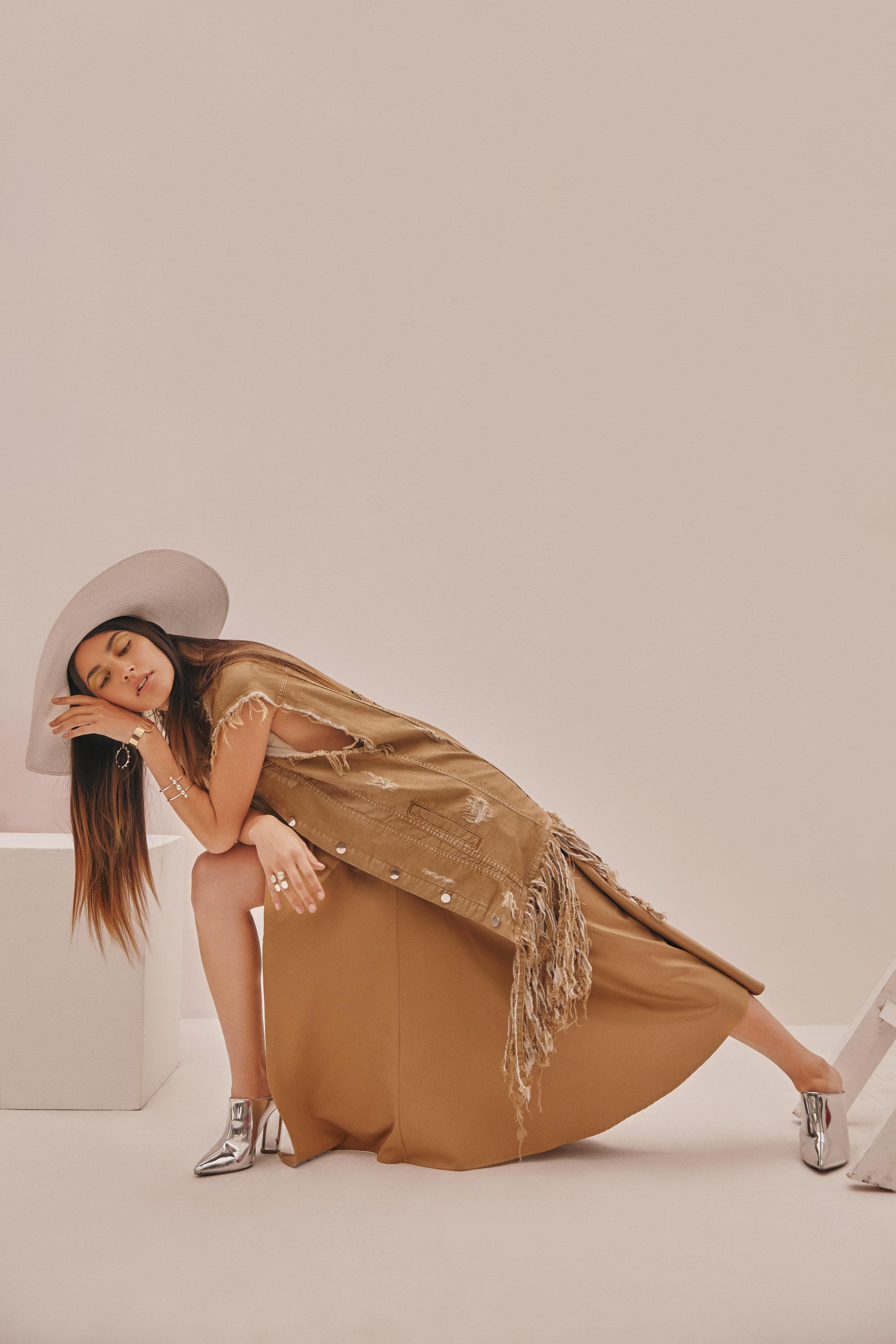 Denim vest:Alexandra Bueno- Skirt:Carlo Carrizosa- Hat: Lina Osorio - Jewelry: LaSierra Jewelry & Aysha Bilgrami- Boots: Stylist's own.