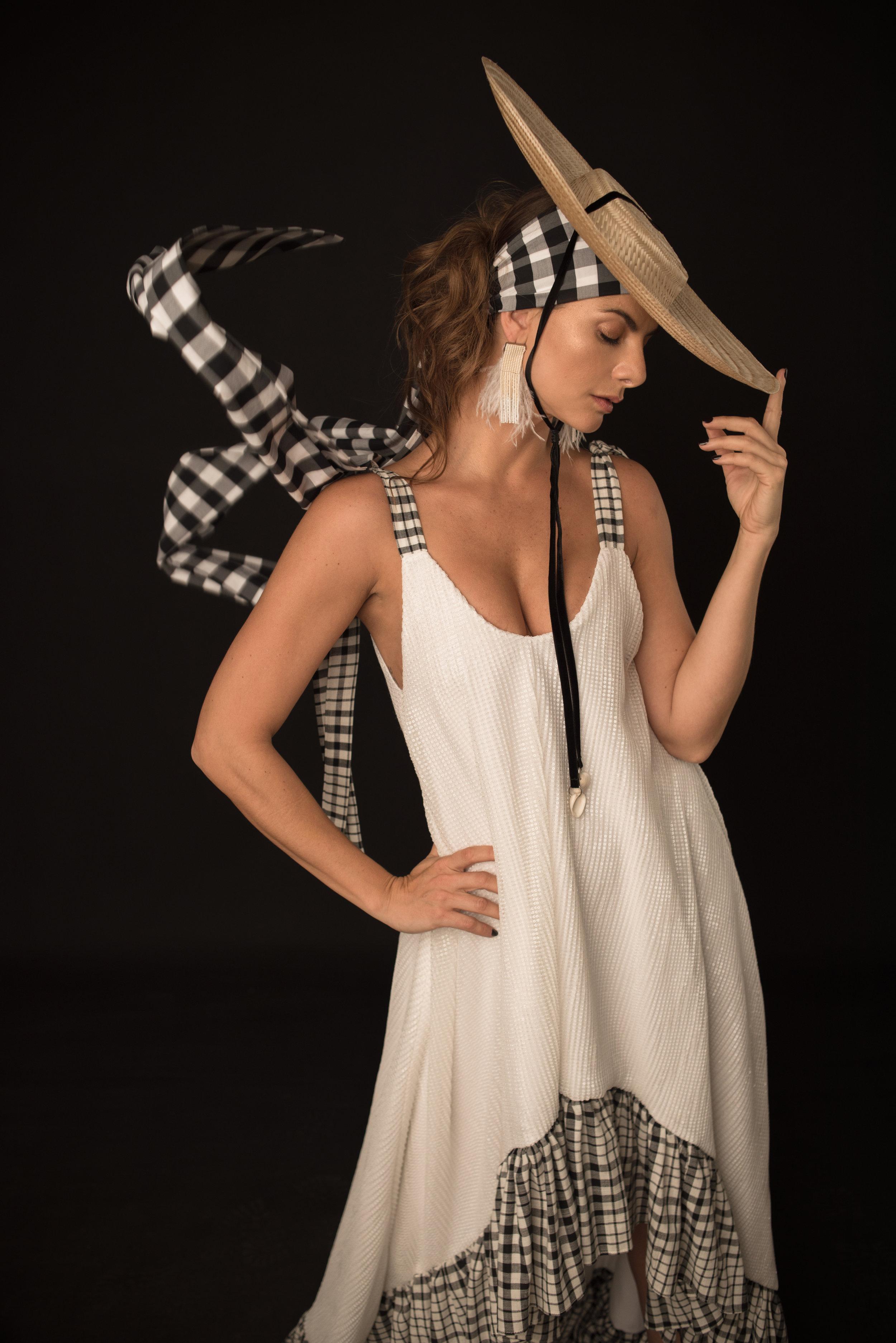 Dress. Alexandra Bueno / Hat. Roma Hatmakers for La Couture Maison / Earrings. Adriana Tavera