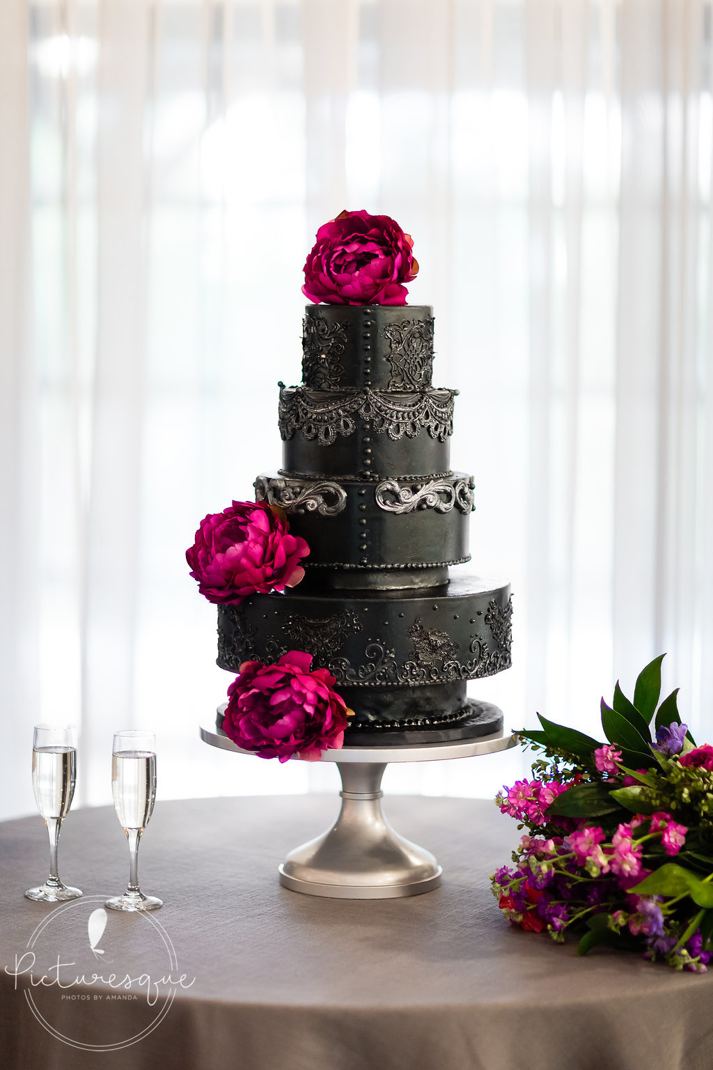 Black silver cake weddings of tulsa.jpg