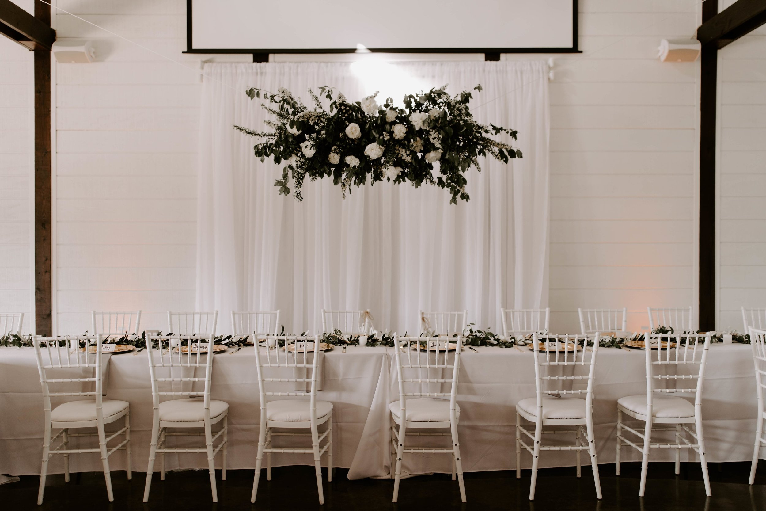 floral installation tulsa wedding venue head table-min.jpg