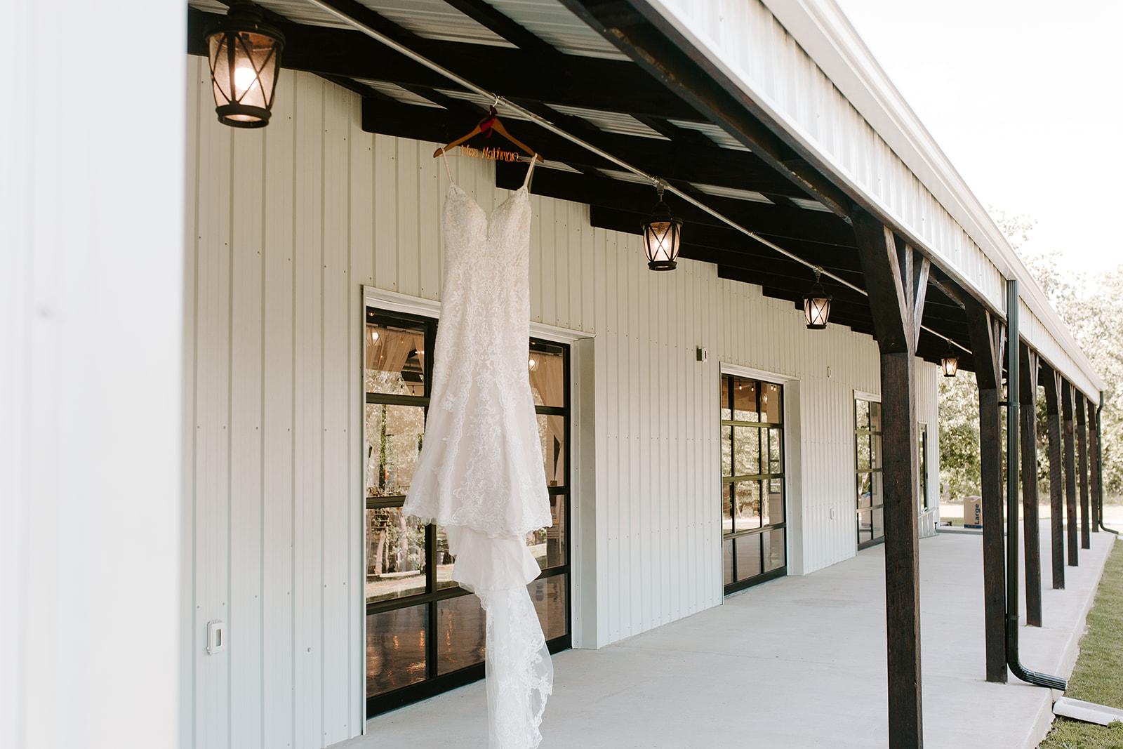 Wedding Venues in Tulsa white barn Dream Point Ranch 1.jpg