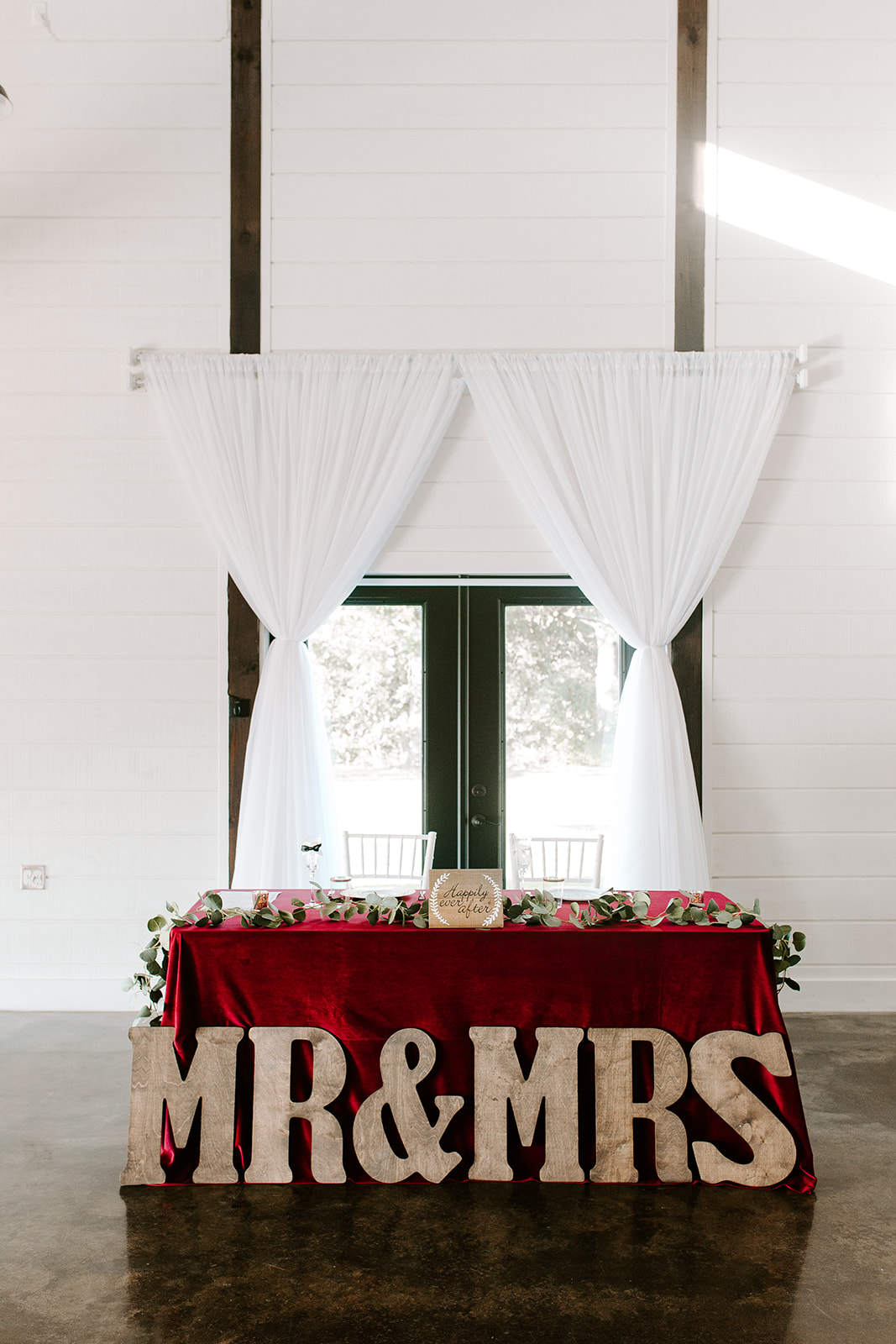 Wedding Venues in Tulsa white barn Dream Point Ranch 8.jpg