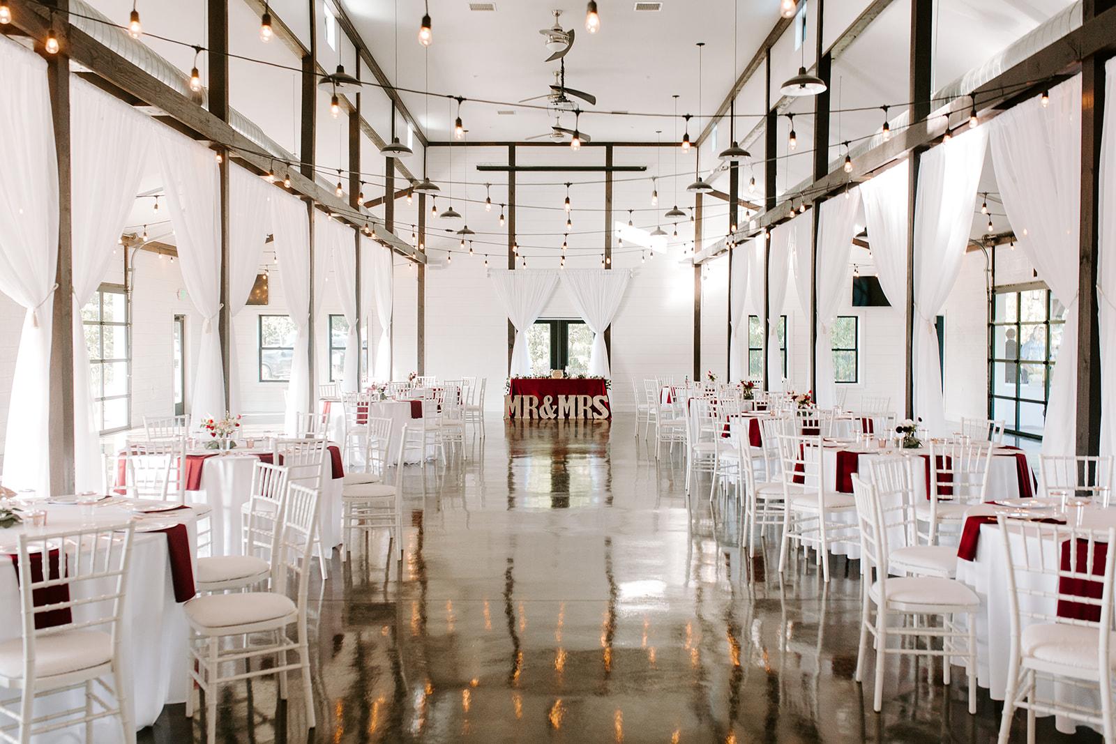 Wedding Venues in Tulsa white barn Dream Point Ranch 11.jpg