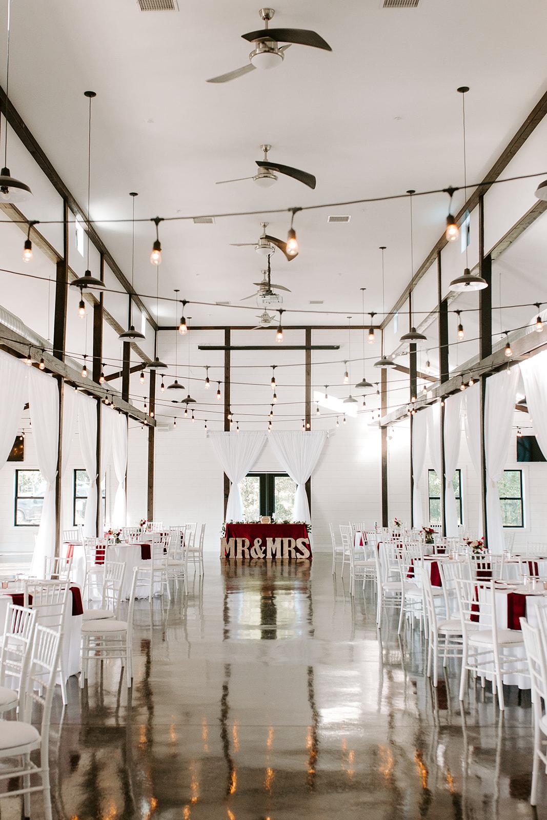 Wedding Venues in Tulsa white barn Dream Point Ranch 12.jpg