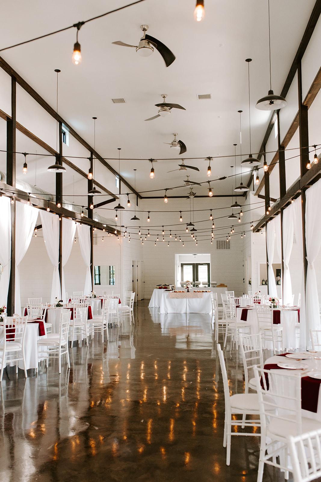 Wedding Venues in Tulsa white barn Dream Point Ranch 16.jpg