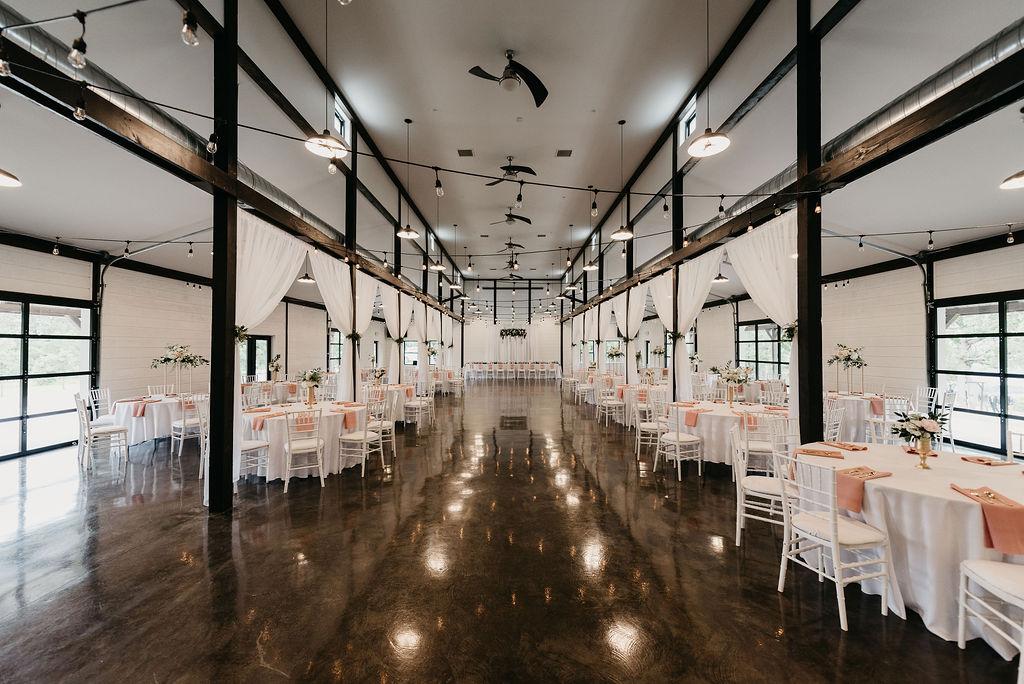 Bright light white barn wedding venue with a view Tulsa Oklahoma 1.jpg