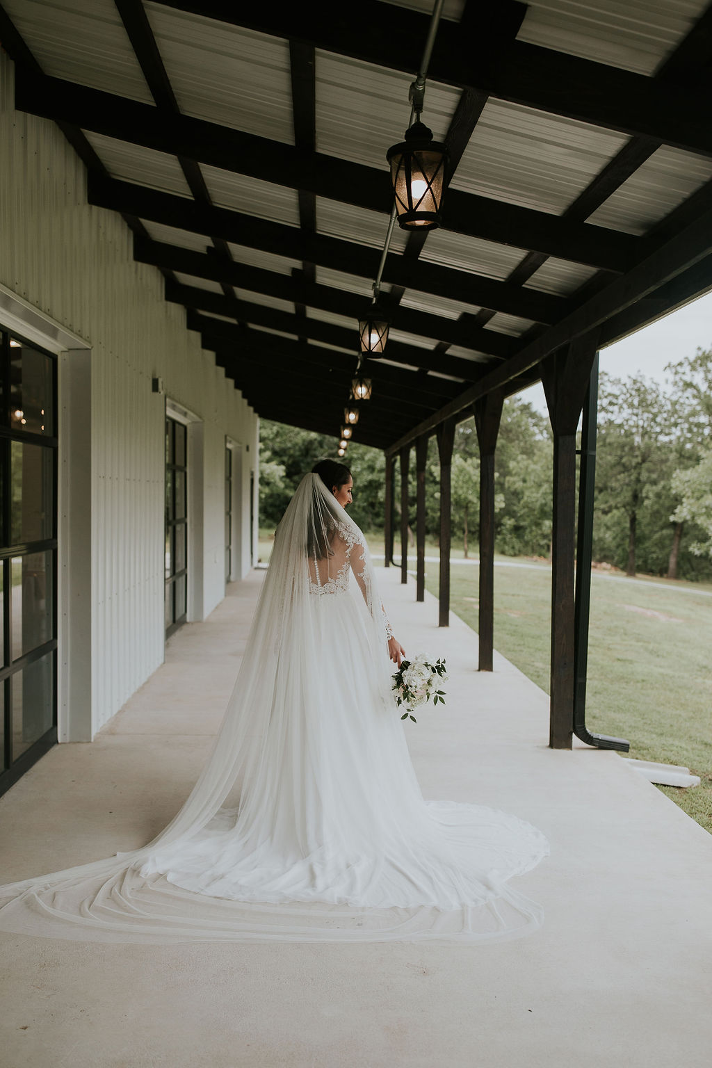 Bright light white barn wedding venue with a view Tulsa Oklahoma 20.jpg