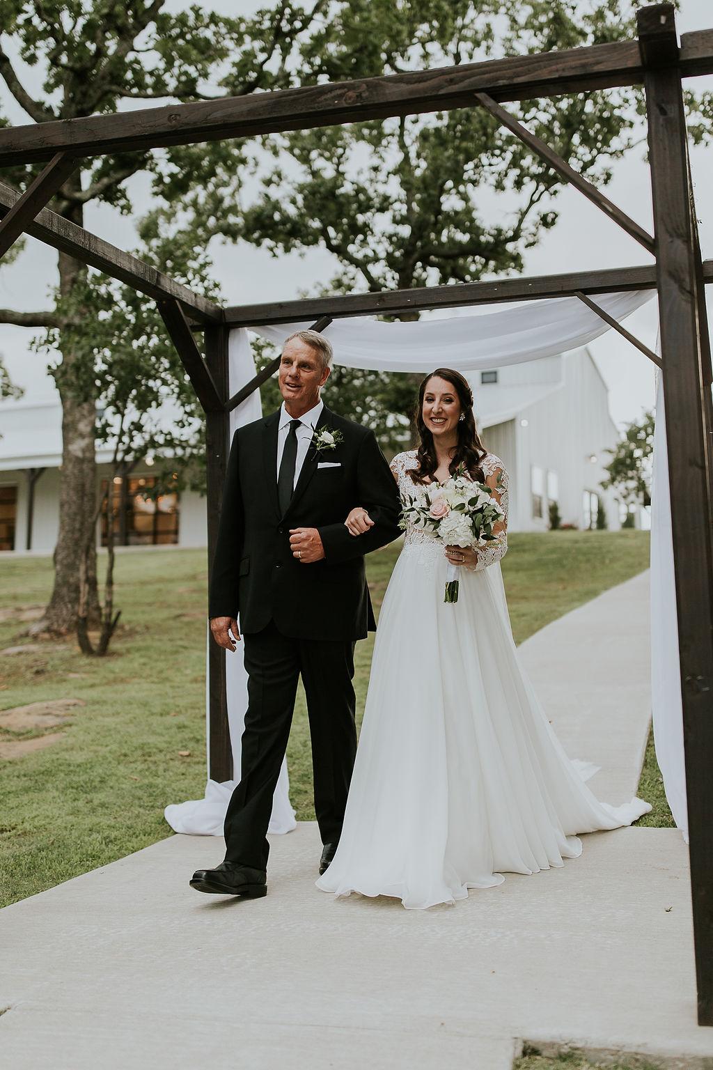 Bright light white barn wedding venue with a view Tulsa Oklahoma 39b.jpg