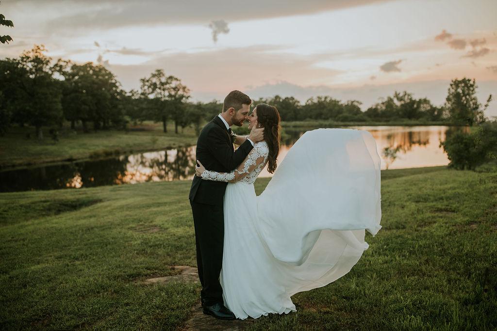 Bright light white barn wedding venue with a view Tulsa Oklahoma 60.jpg