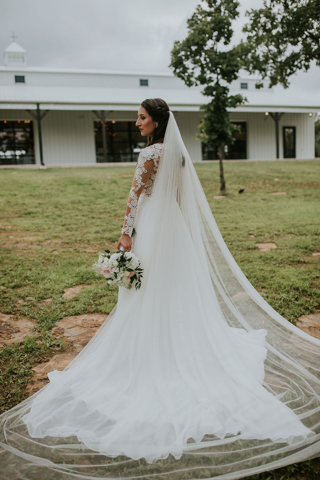 Bright light white barn wedding venue with a view Tulsa Oklahoma 16.jpg